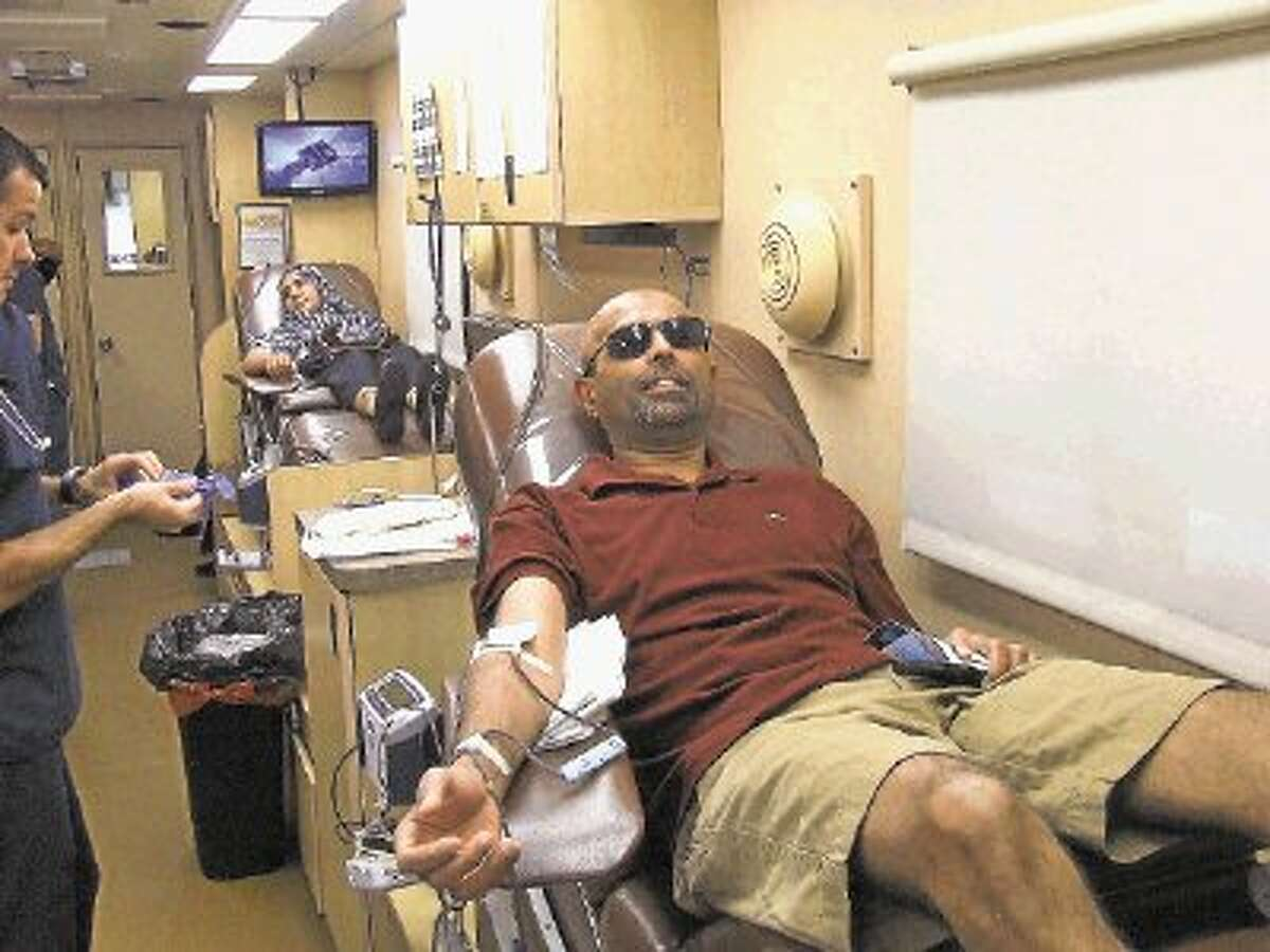 Yesmeen Rizvi donates blood at a blood drive sponsored by the Houston branch of the