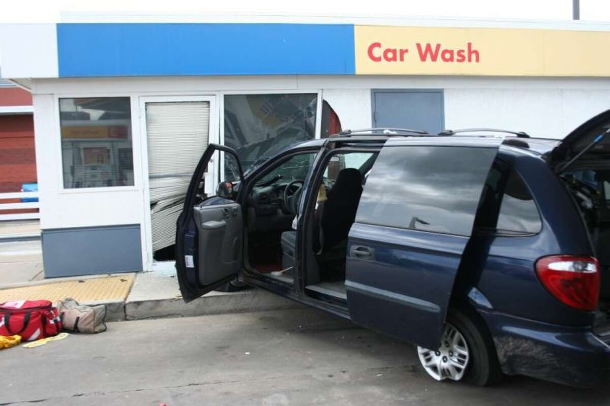 A blue minivan crashed into the Shell carwash on FM 1314 near Interstate Highway 59.