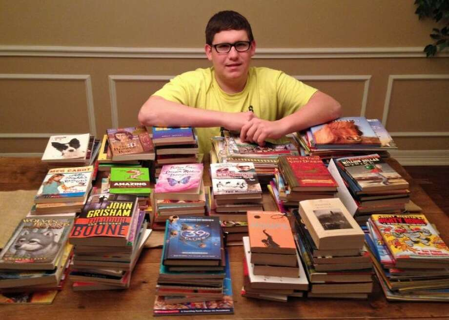 Through the Lone Star Youth Leadership Council, Berry Miller Junior High's Tyler Thames helped collect books to rebuild West ISD libraries. Photo: Courtesy Pearland ISD