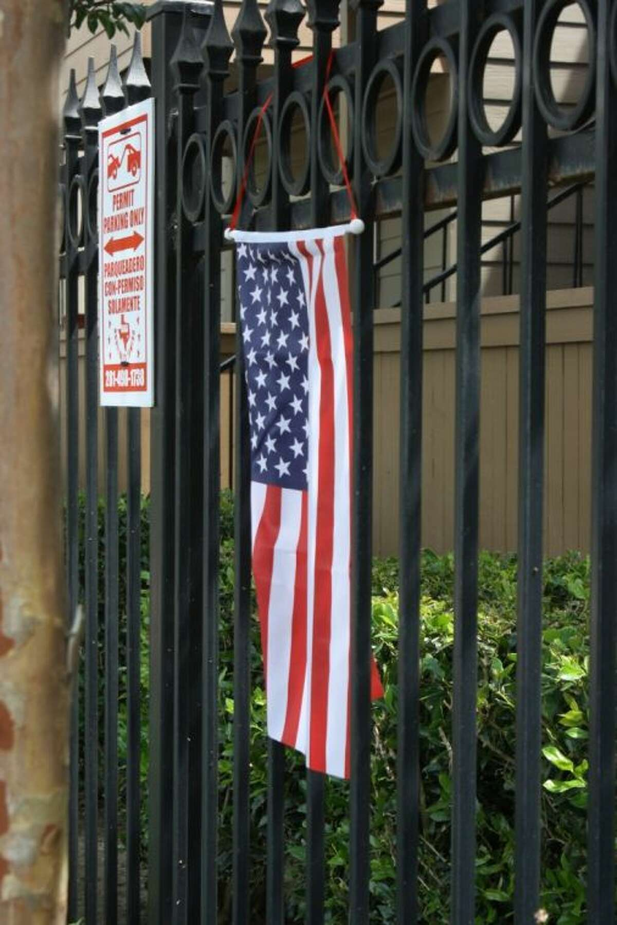 The Citizen was unable to contact the man and apartment managment officials declined comment. The Citizen was able to verify that several American flags were visibly displayed at the complex, including on balconies and lining the entrance.