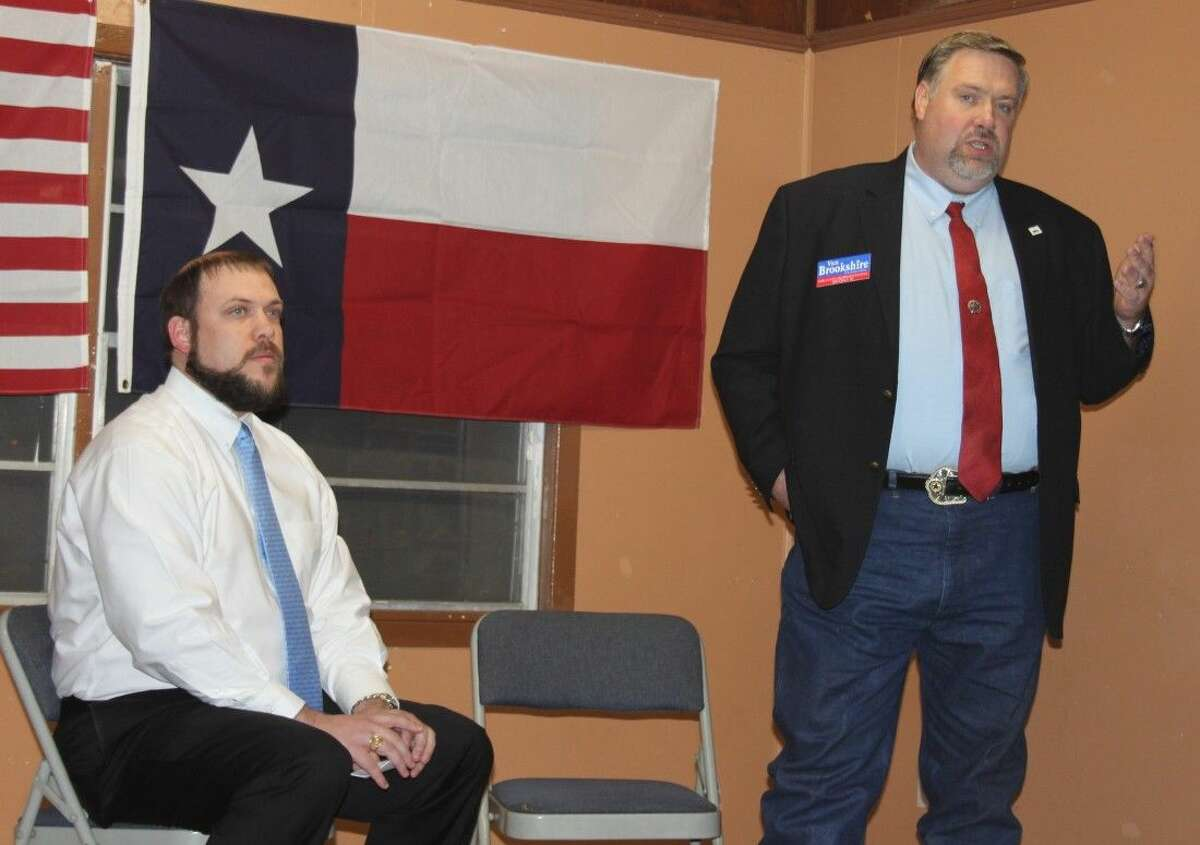 HD 18 candidate Van Brookshire (right) describes his views on supporting private schools with state funding. Seated to his left is John Baucum of the Republican Liberty Caucus.
