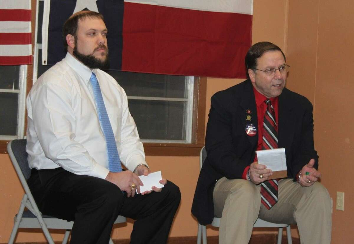 HD 18 candidate James Morrison (right) expresses his views on the proposed policy for school choice, stating his support for the idea. John Baucum (left) of the Republican Liberty Caucus moderated the event.