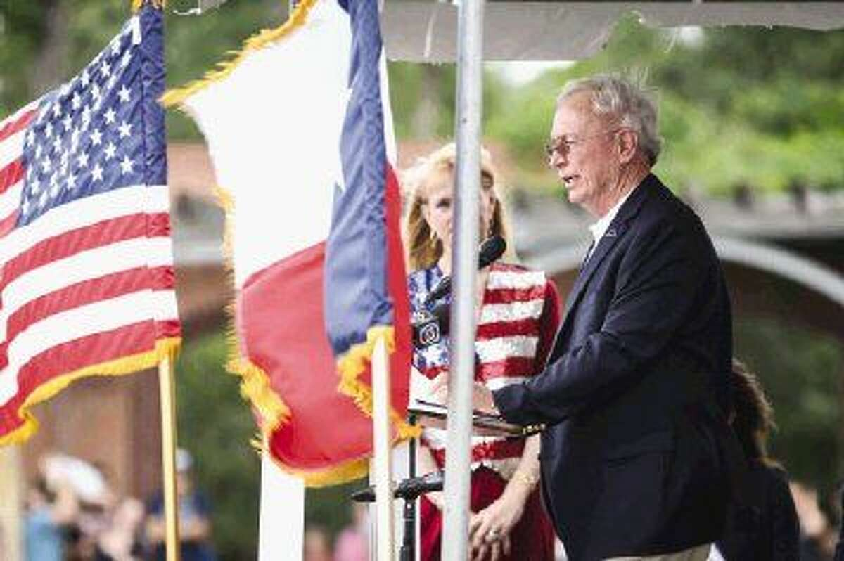 Sculptor Edd Hayes speaks during The Way Home Veterans Memorial project unveiling on Monday at Town Green Park.