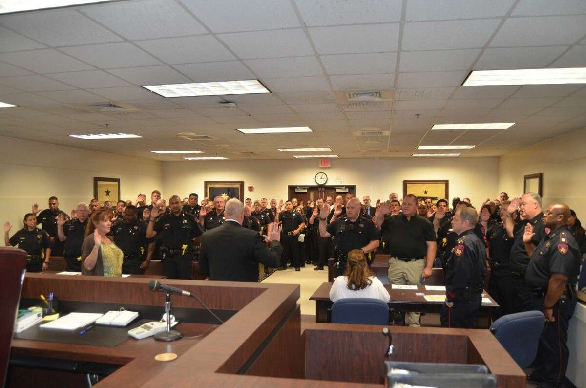 New Harris County Precinct 4 Constable Mark Herman conducts the swearing in ceremony May 26, 2015.