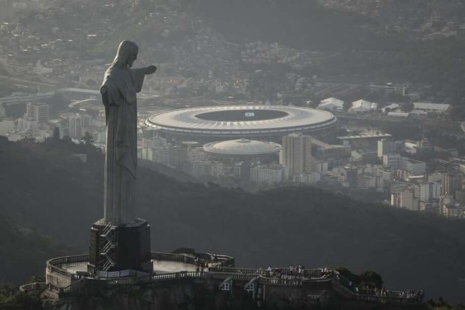 This aerial photo shot through an airplane window shows the Maracanã stadium behind the Christ the Redeemer statue on May 13 in Rio de Janeiro.