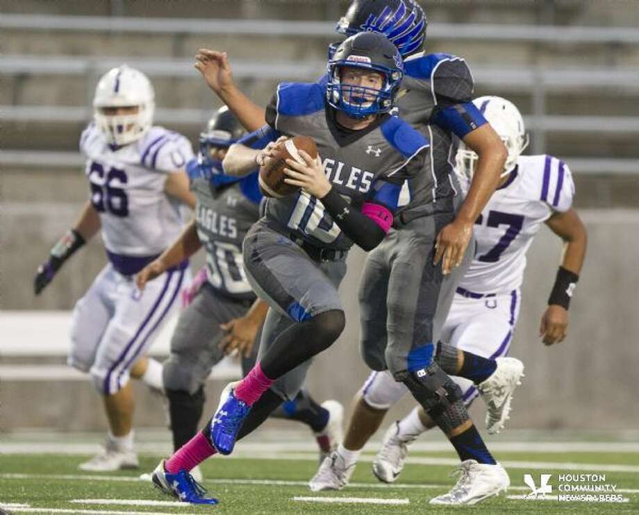 New Caney quarterback Timmy Ware runs the ball during the first half of a District 21-5A football game Saturday. To view or purchase this photo and others like it, visit HCNpics.com. Photo: Jason Fochtman