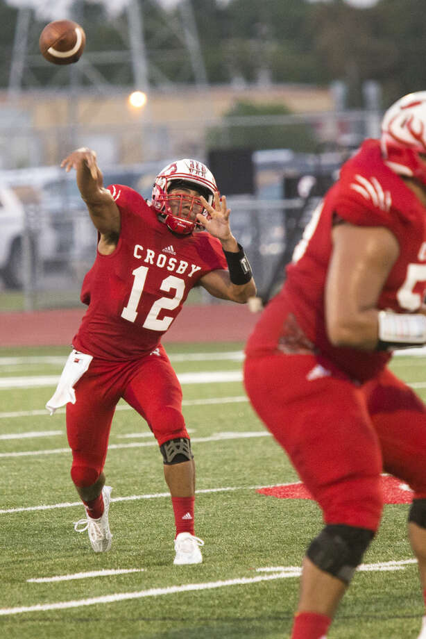 Cougars quarterback Tristen Cotton (12) passes during Crosby's 34-0 victory over Angleton on Sep. 4, 2015, at Crosby High School. Photo: ANDREW BUCKLEY