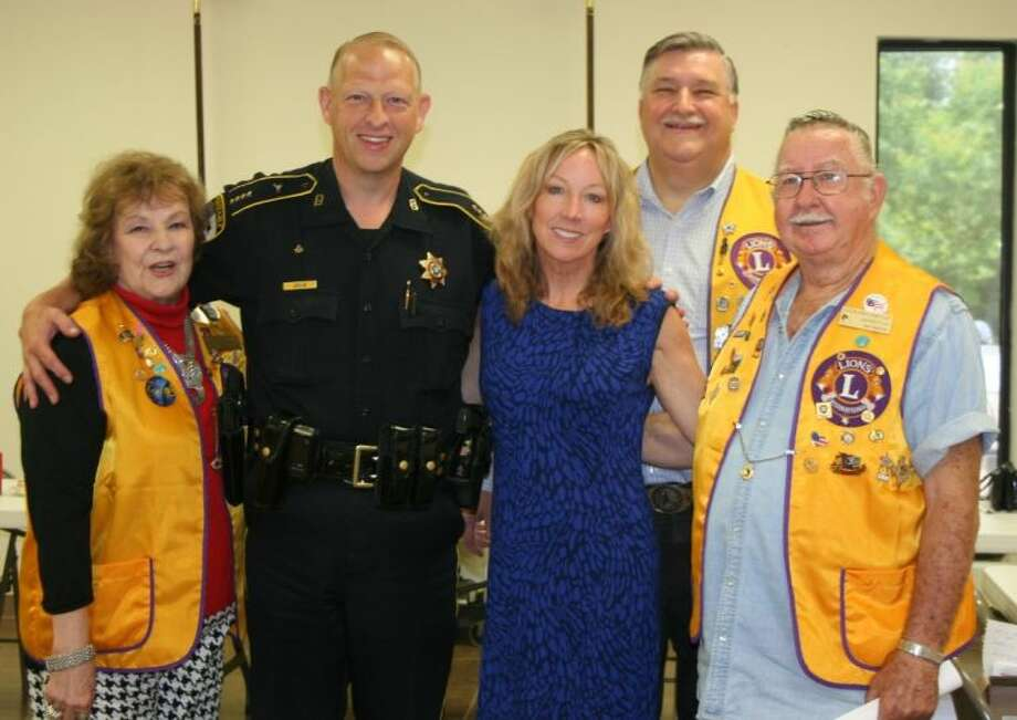 Liberty County Pct. 6 Constable John Joslin poses with Cleveland Lions Club members Beverly Eriks, Mike Penry and Ray Martin during the June 17 meeting of the club. Car care specialist Lynn Beckwith, of Beckwith's Car Care in Humble, was the guest speaker at the meeting. Photo: STEPHANIE BUCKNER