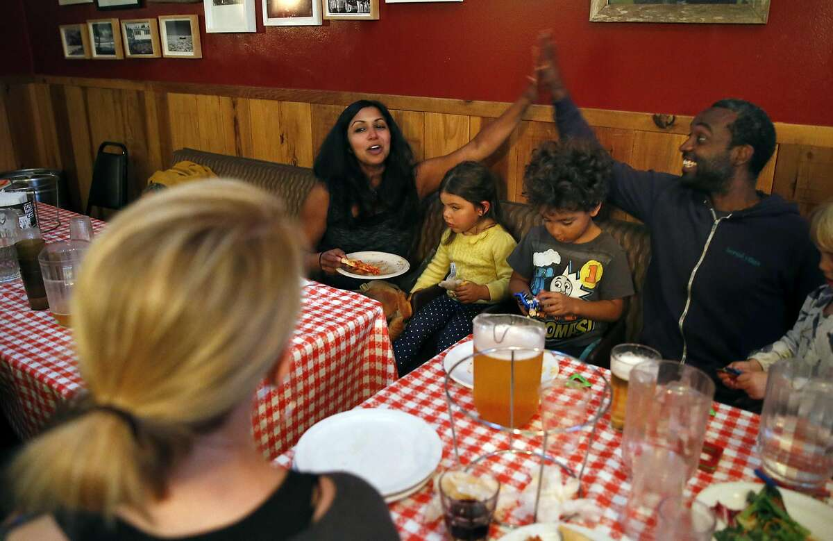 (left to right) Teachers and new home owners Bridget Early, Harini Madhavan and Kai King during pizza party celebrating their purchases in San Francisco, Calif., on Monday, October 3, 2016.