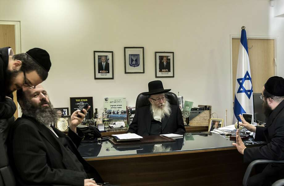 Israeli Health Minister Yaakov Litzman (center) is unapologetic about the insular lifestyle he advocates and which has long irked mainstream Israel and endangered its long-term economic prospects. Photo: Tsafrir Abayov, Associated Press
