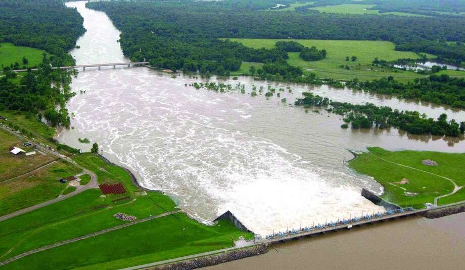 The Lake Livingston Dam is seen on May 28, 2015. Four times in 2015, residents in riverfront neighborhoods along the Trinity River were subjected to flooding that closed their access roads and forced many to flee to higher ground. Photo: Jason Fochtman
