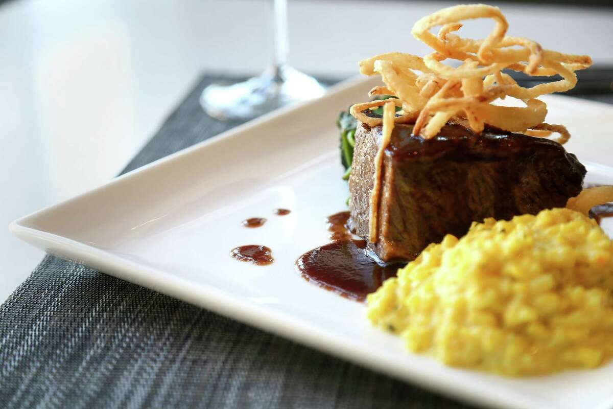 A dish of short ribs with saffron risotto, spinach and crispy onions at Third Coast, the new restaurant (replacing Trevisio) at Texas Medical Center.