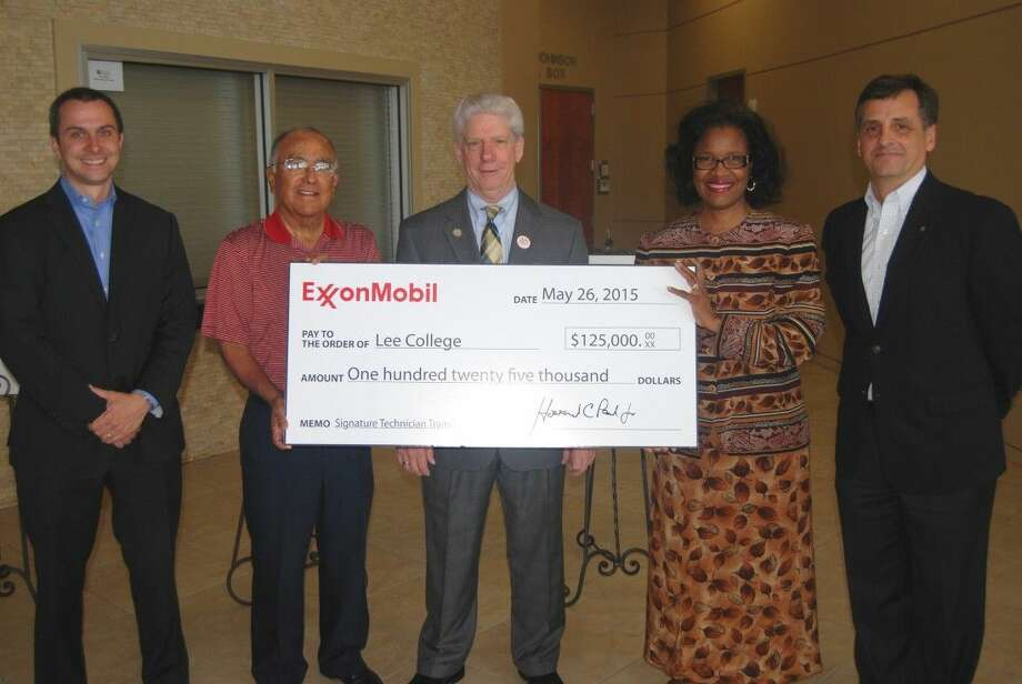 ExxonMobil presents Lee College with the first of three donation checks totaling more than $210,000 during a special reception held Tuesday, May 26, on campus. Pictured (l-r) are Matthew Crocker, manager of the ExxonMobil Baytown Refinery; Pete C. Alfaro, member of the Lee College Board of Regents; and Pres. Dr. Dennis Brown.