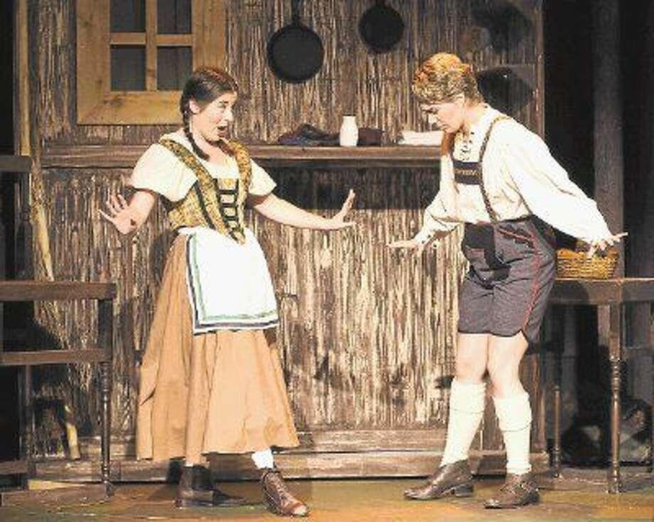 Megan Berti (right) is seen here as Hänsel in Oh!'s Hänsel und Gretel in 2014. (Allison Pohl is Gretel.) Berti sings the role of Cenerentola in Rossini's La Cenerentola at Opera in the Heights Feb. 5-13. Photo: Deji Osinulu
