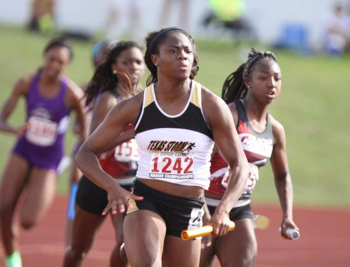 Runners in the 4x100 Meter Relay compete during the 2014 USATF Region 16 Junior Olympics Outdoor Championships June 21 at Barrett Stadium in Houston.