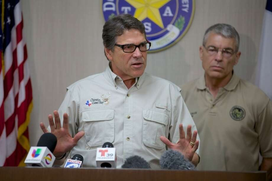 Perry talks border security after touring a holding facility. Photo: Governor Rick Perry's Office