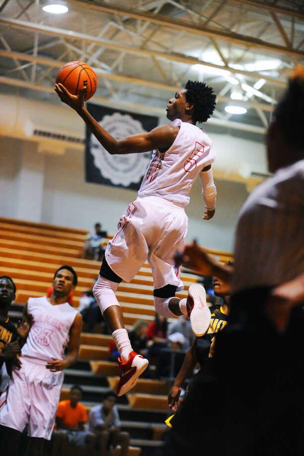 Cypress Lakes senior guard De'Aaron Fox scored 36 points in the 77-74 loss to Cypress Ranch at Cy Ranch High School Friday, January 29, 2016. Fox connected on five three-pointers in the fourth quarter, but it was not enough to overcome the Mustangs. Photo: Tony Gaines