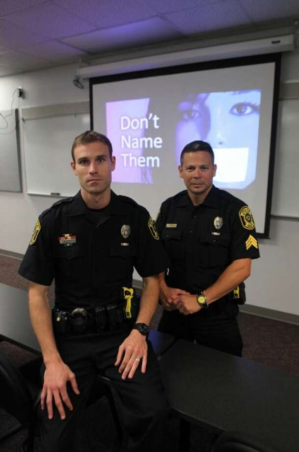Sugar Land Police Officer Joe Carter and Sergeant Rudy Ramirez lead the department's C.R.A.S.E. (Civilian Response Active Shooter Event) presentation program in Sugar Land on Thursday, June 19. Photo: Alan Warren
