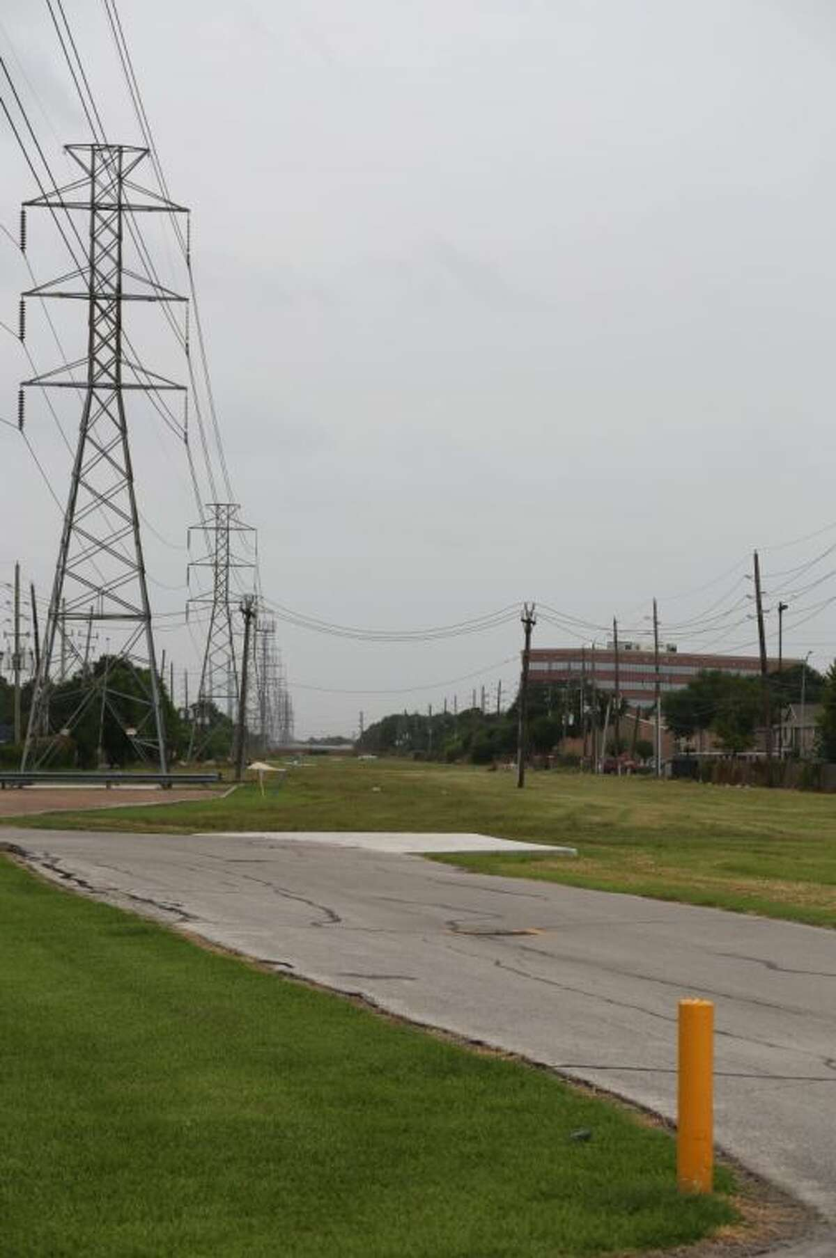 The Westchase District is negotiating with CenterPoint to put a hike and bike trail on this corridor. This view is looking south from near Westheimer toward Richmond.