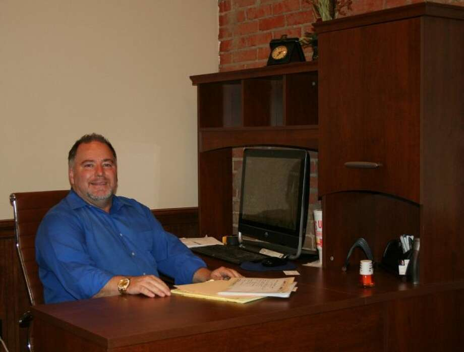 Realtor Thomas Davidson is getting settled into his new office at the building at the corner of Crockett St. and San Jacinto Ave. in Cleveland, where he is working to lease the surrounding offices in the building. Photo: STEPHANIE BUCKNER