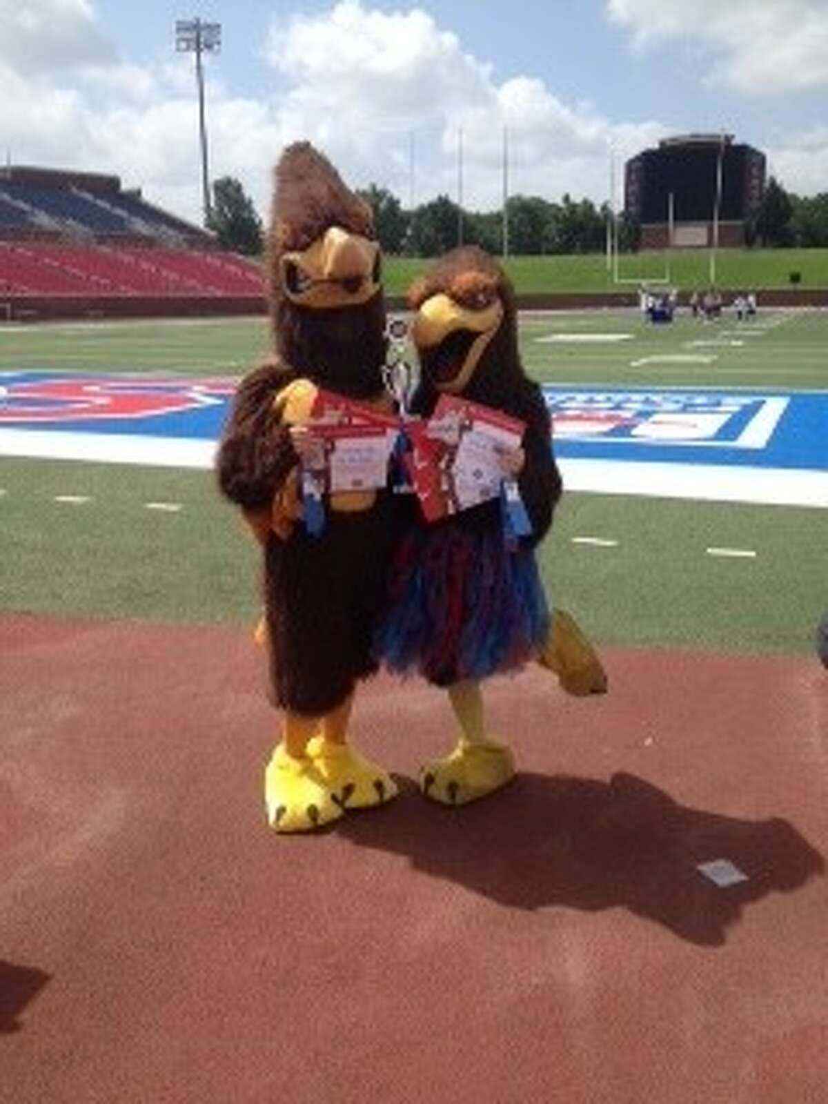 The Clear Lake mascots, Flip and Flex, were top performers at the National Cheerleading Association camp in Dallas.