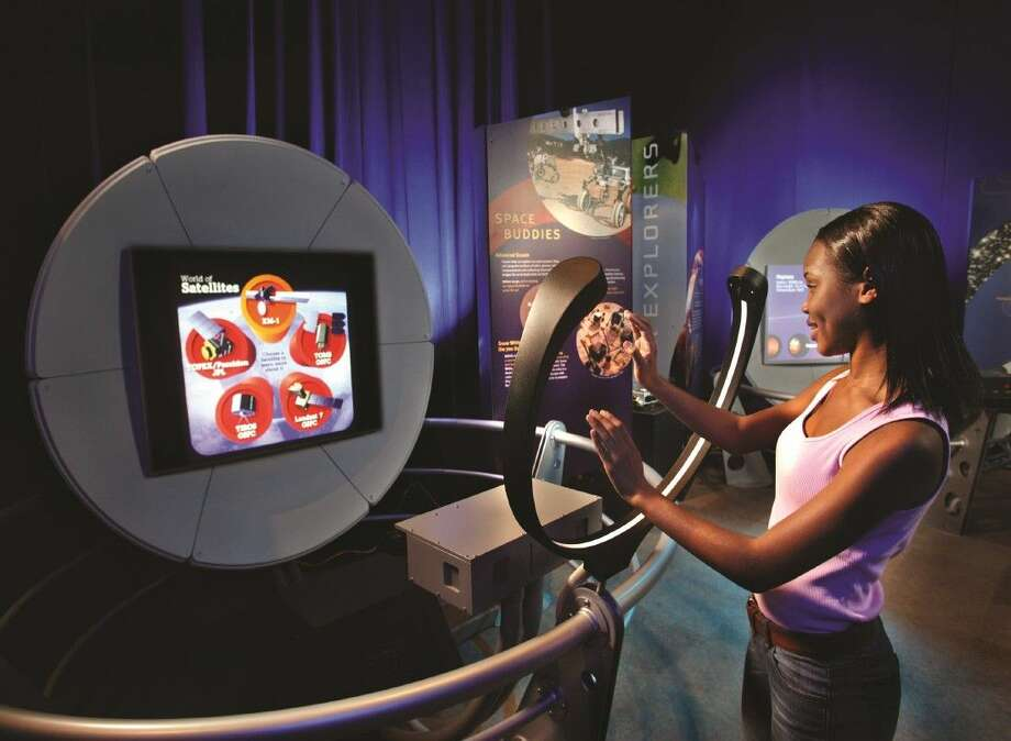 """A young woman trains for an imaginary mission to Mars in Space Center Houston's summer exhibit,""""Space: A Journey to Our Future,"""" May 23-Sept. 7. Photo: Courtesy Photo"""