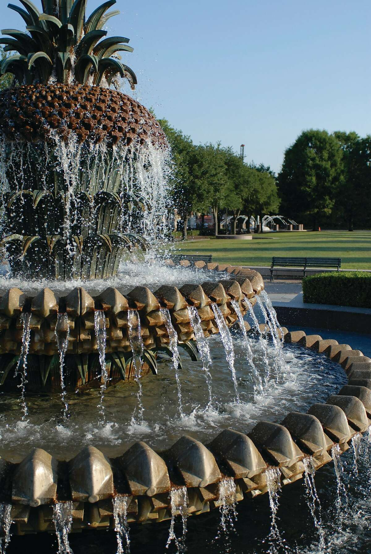 The Pineapple Fountain in Waterfront Park tracing the Cooper River is one of two huge fountains that welcome children to play in the cascading water. Charleston Area CVB.
