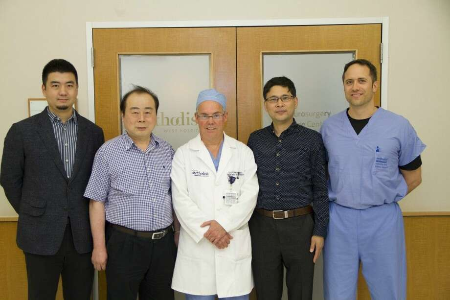 Hospital welcomes two surgeons from China to observe surgery