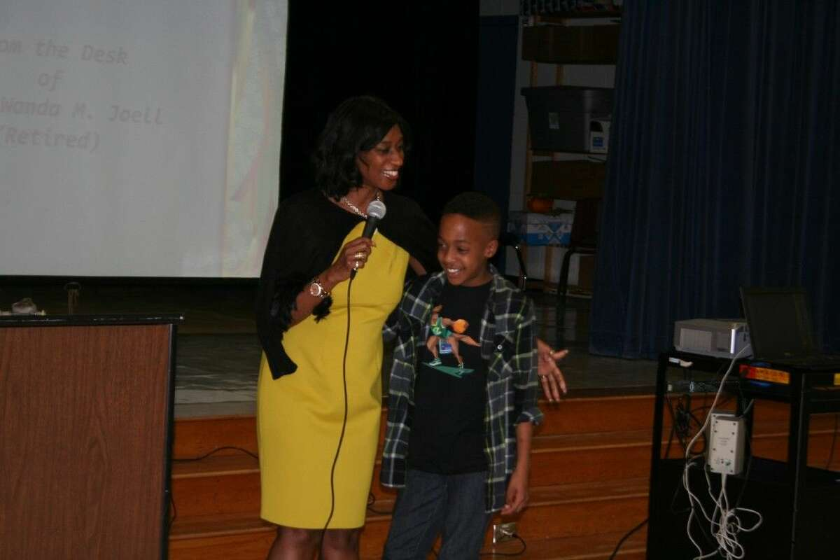 Air Force Senior Master Sgt. Ret. Wanda Joell with her cousin shares her experiences as the first African American woman flight attendant working aboard Air Force One at Timbers Elementary Feb. 4, 2016.