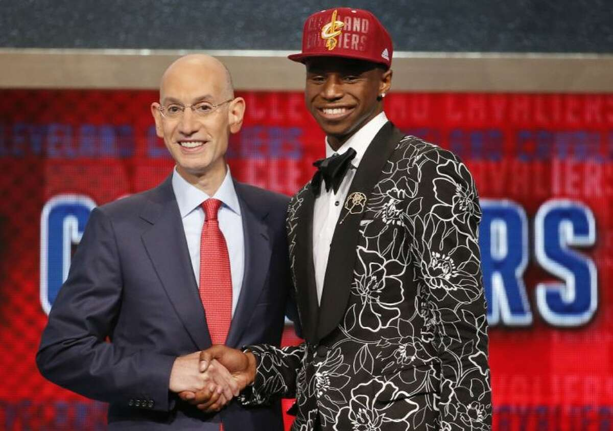 NBA Commissioner Adam Silver, left, congratulates Andrew Wiggins of Kansas who was selected by the Cleveland Cavaliers as the number one pick in the 2014 NBA draft Thursday in New York.