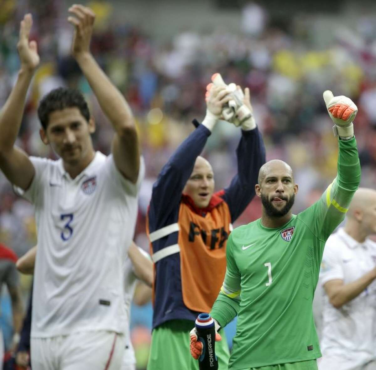 United States goalkeeper Tim Howard (1) and his teammates celebrate after qualifying for the second round of the World Cup following their 1-0 loss to Germany.