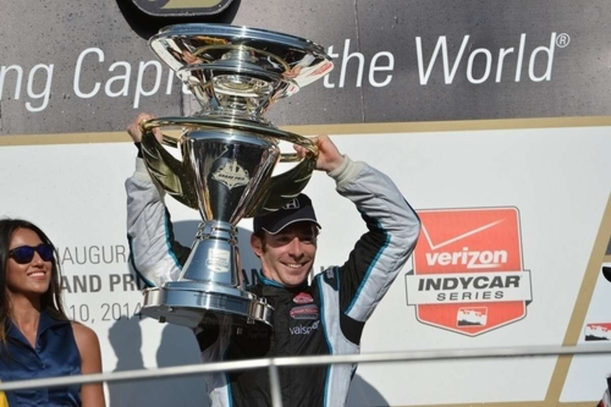 Schmidt Peterson Hamilton Motorsports driver Simon Pagenaud raises the trophy after winning the 2014 Grand Prix of Indianapolis. Pagenaud and SPHM are partnered with Katy-based Kingdom Racing and will compete in the Grand Prix of Houston, June 27-28 at Reliant Park.