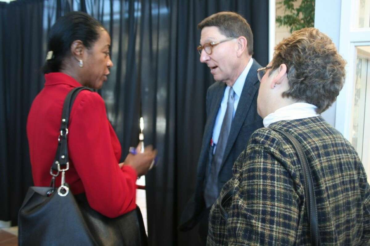 H-E-B Houston Division president speaks with guests after the luncheon.