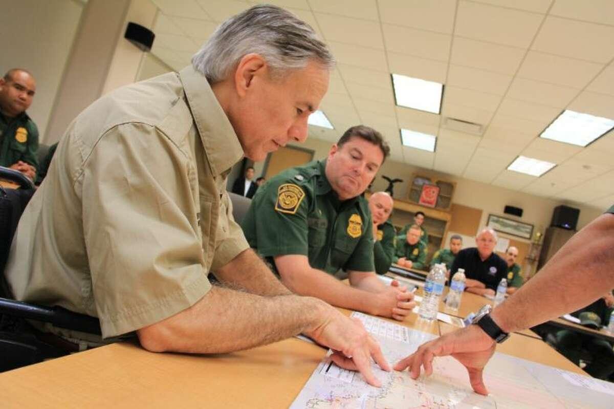 U.S. Border Patrol officials brief Attorney General Greg Abbott on border security issues on Friday, June 27.