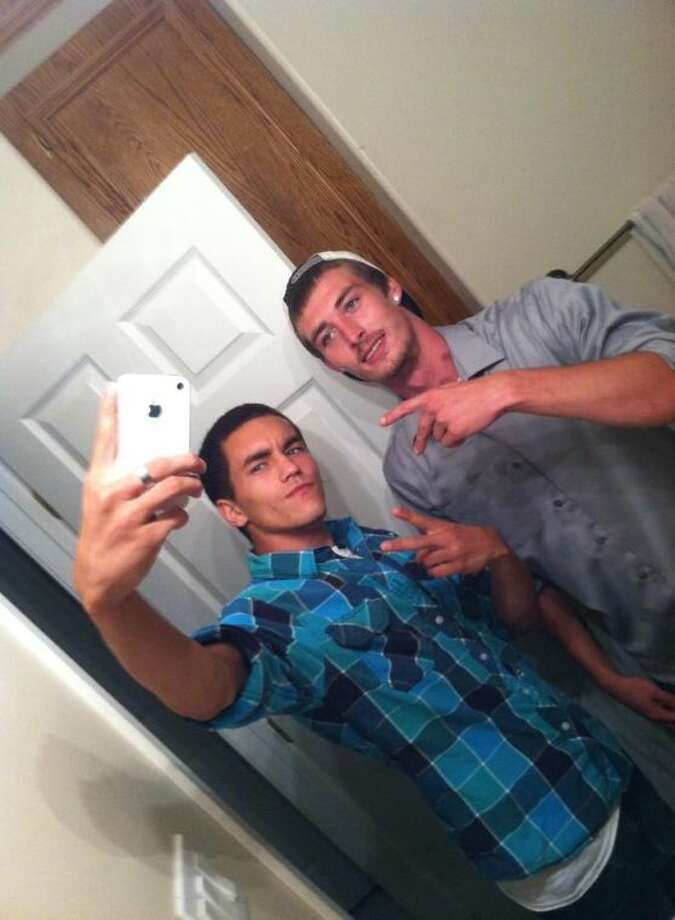 In a publicly shared photo available through Facebook, Reed Thornton, left, poses with Joseph Castellow, right.
