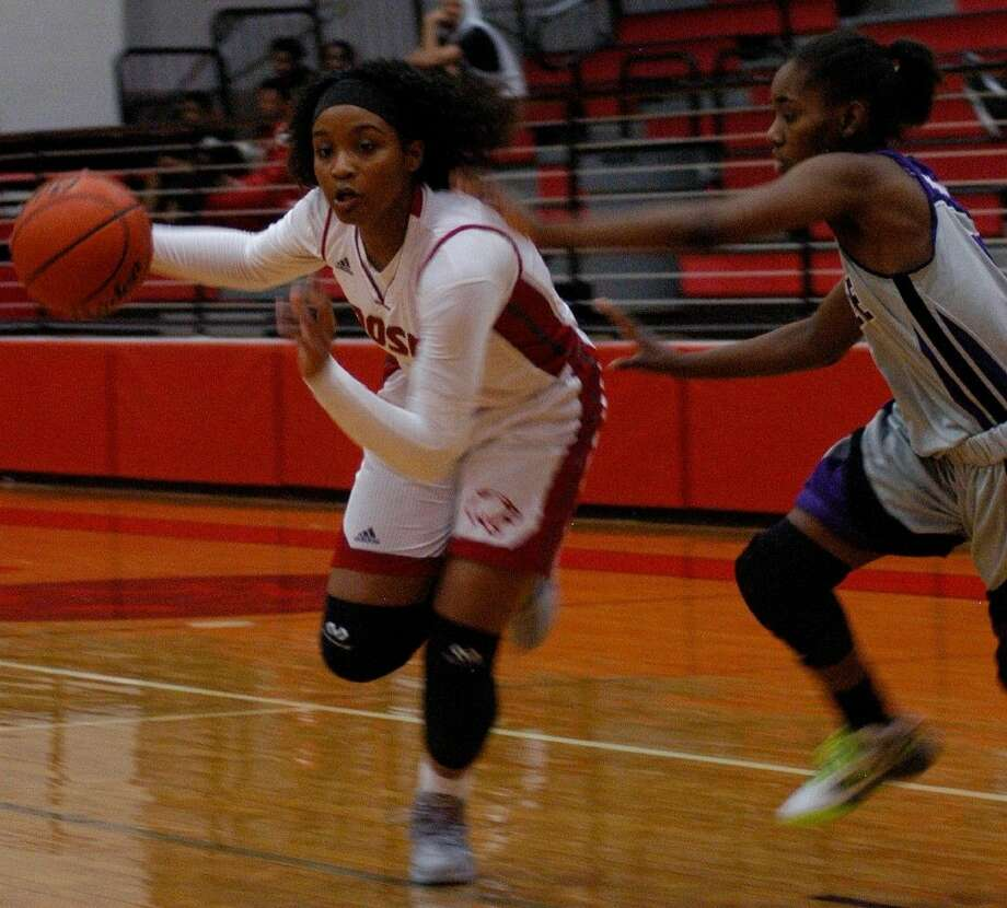 Crosby's Paris Netherly drives towards the hoop during a game agaisnt Humble earlier this year.