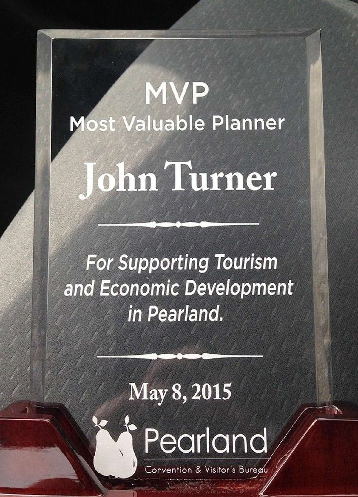 Pearland High School head volleyball coach John Turner received Pearland Convention and Visitor's Bureau's Most Valuable Planner Award.