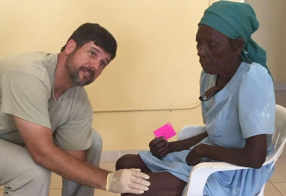 Jake Hicks provides much needed medical care to the people of Haiti.