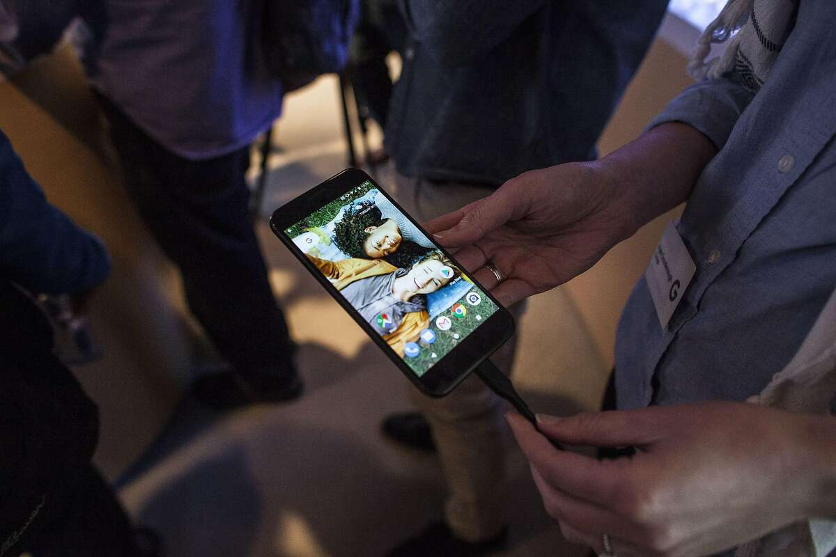 SAN FRANCISCO, CA - OCTOBER 04: Members of the media examine Google's Pixel phone during an event to introduce Google hardware products on October 4, 2016 in San Francisco, California. Google unveils new products including the Google Pixel Phone making a jump into the mobile device market. (Photo by Ramin Talaie/Getty Images)