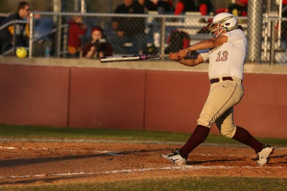 Magnolia West's Madison Washington (13) swings while at bat during the high school softball game against Caney Creek on Tuesday, March 11, 2014, at Magnolia West High School. To view or purchase this photo and others like it, go to HCNPics.com. Photo: Michael Minasi