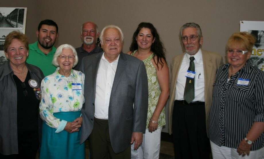 Alexander Pollak (center) poses with his team of supporters at the Humble Rotary luncheon June 10, 2015.