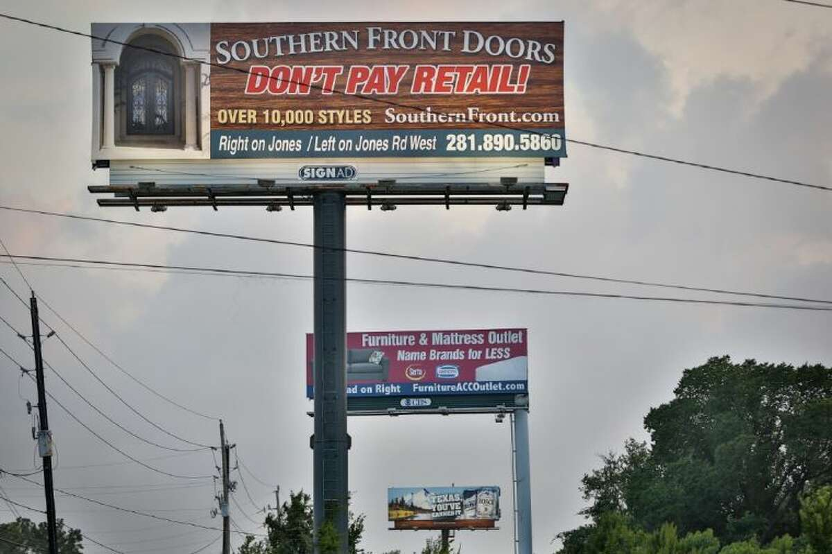 A series of billboards dot the side of the FM 1960, near 249, on June 28, 2014.