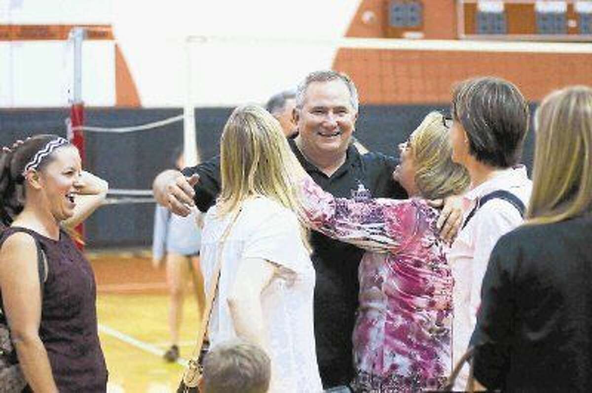 Pearland volleyball coach John Turner, shown here after his 700th career win, has been selected for the Pearland Convention and Vistors Bureau's most valuable planner award.