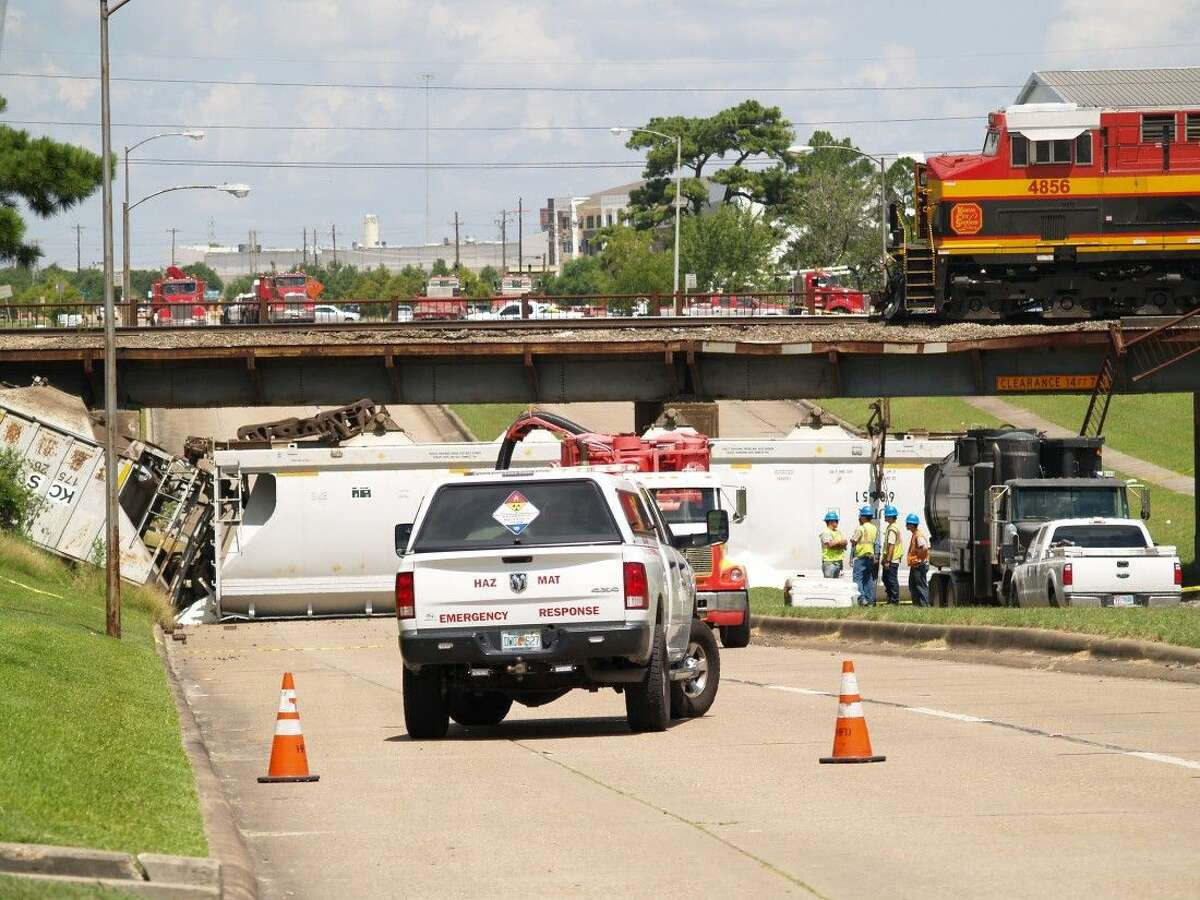 Nine cars came off the rails and two cars tumbled onto Old Katy Road near Washington Avenue this morning. No injuries were reported.