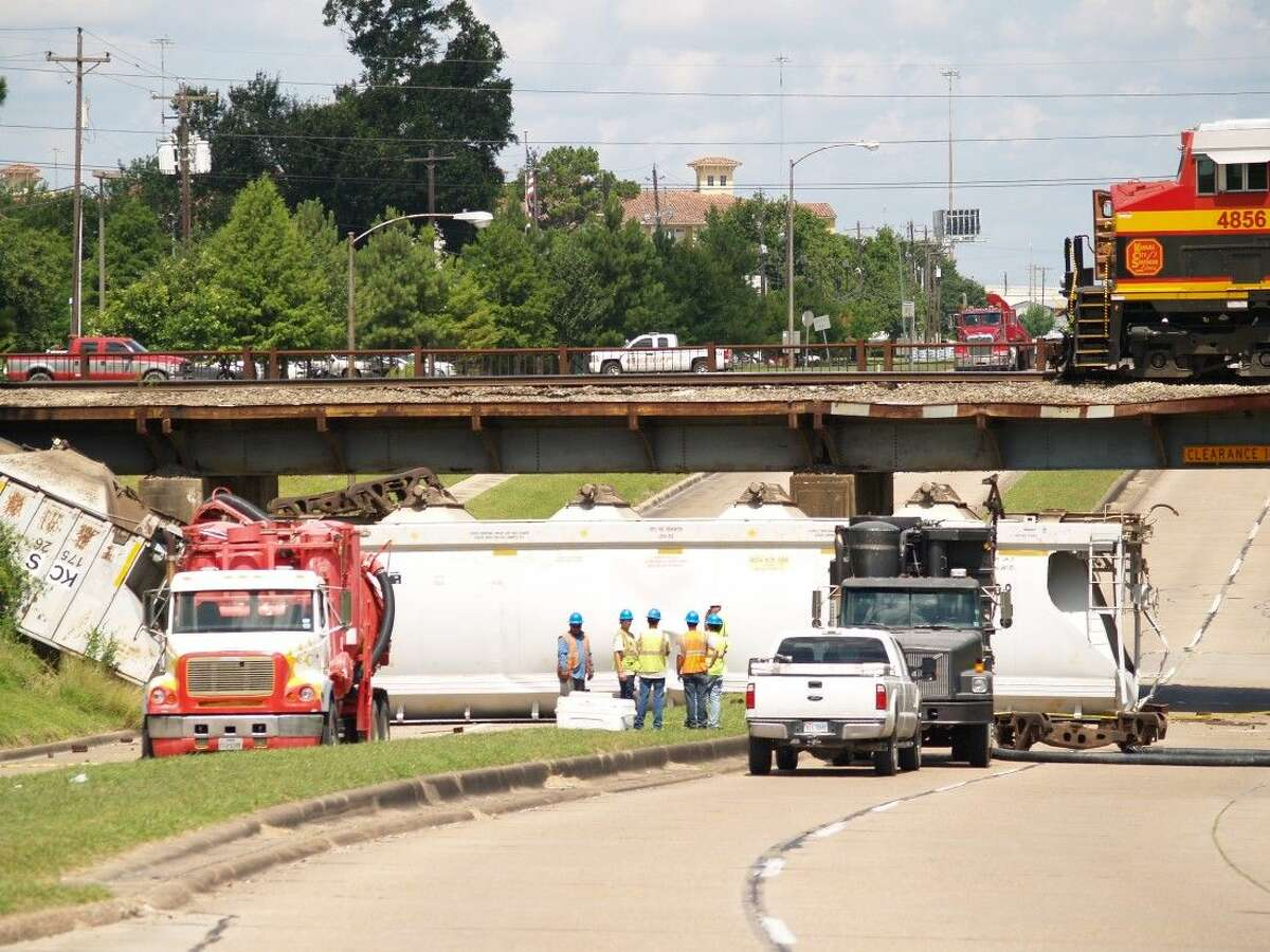 Old Katy Road is blocked both ways due to the derailment. Repair crews are on site attempting repairs to the cars and tracks