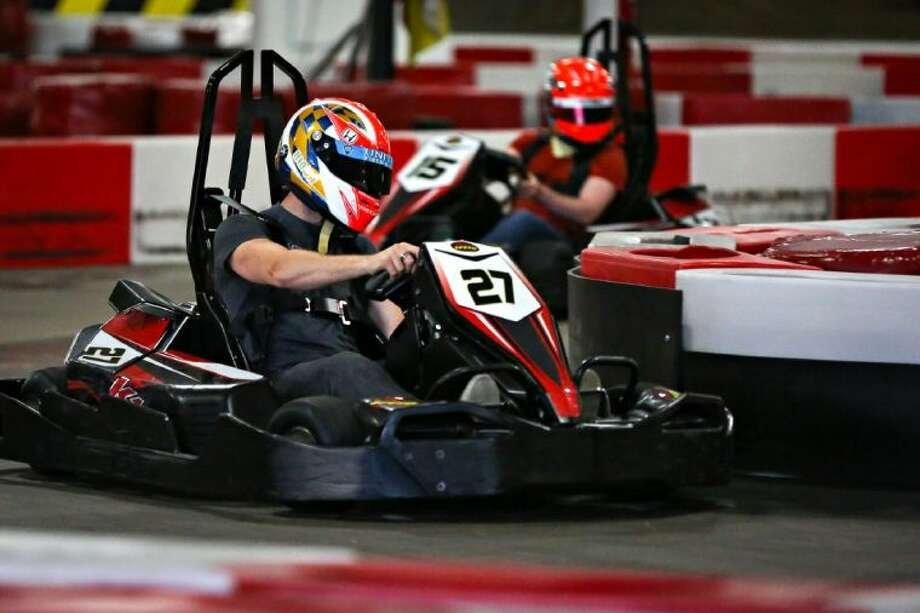 IndyCar star James Hinchcliffe races a speed kart around the track, closely followed by Pro Mazda driver Jose Gutierrez, during a meet and greet between Speed Group members and fans on Thursday, June 26, 2014, at K1 Speed Houston. Photo: Michael Minasi