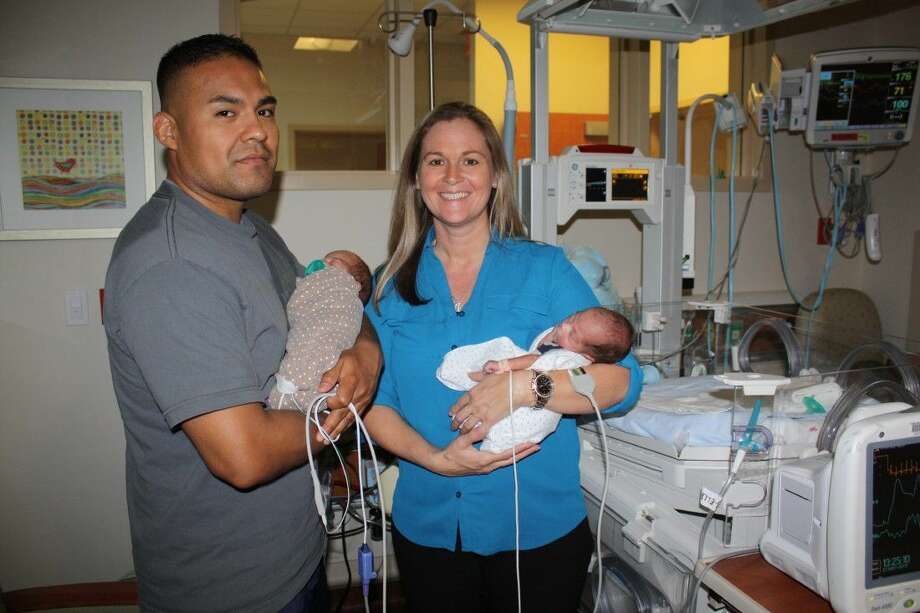 Parents Kristi Elliott and Elias Rodriguez with Elijah and Ezekiel in The Women and Children's Center at Kingwood Medical Center.