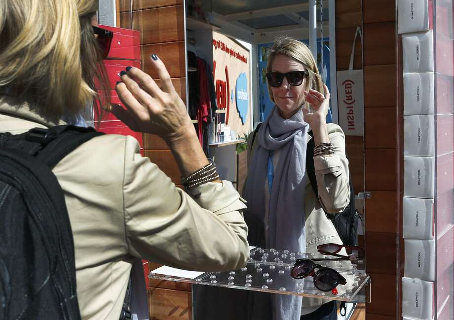 At Dreamforce, Meghan Swanson shops at a pop-up store that will donate proceeds to AIDS research. Photo: Paul Chinn, The Chronicle