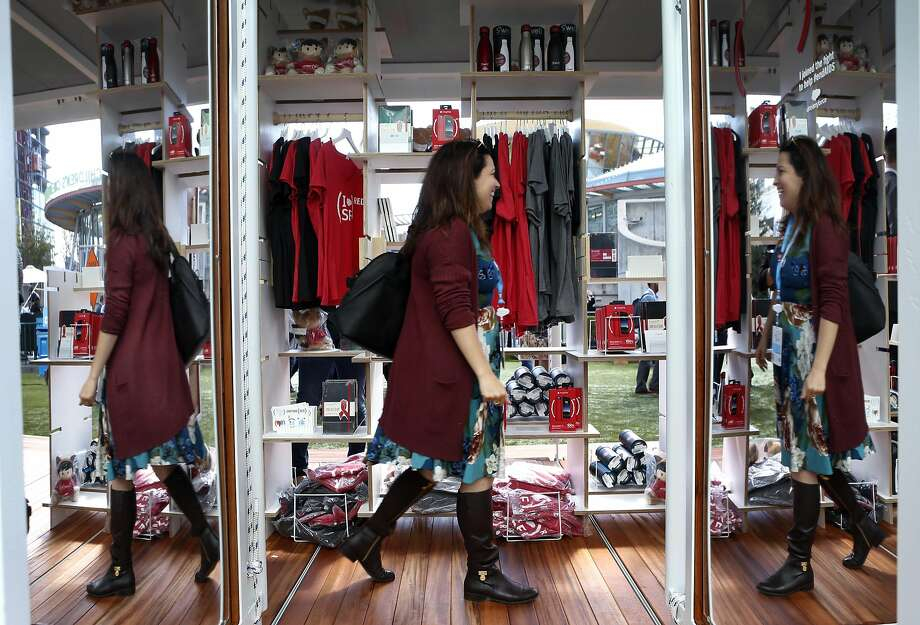 A woman shops in the (RED) pop-up store at the Dreamforce conference in San Francisco, Calif. on Tuesday, Oct. 4, 2016. Proceeds from the products go to AIDS research. Photo: Paul Chinn, The Chronicle