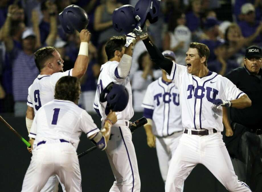 TCU designated hitter Connor Wanhanen, right, celebrates with teammates Cody Jones (1), Evan Skoug (9), and Dane Steinhagen after hitting a two-run home run in the sixth inning. The Horned Frogs defeated the Aggies 5-4 in a game that lasted 16 innings to return to the College World Series.